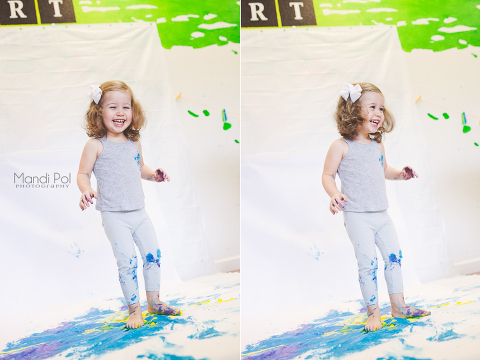 a photo of a little girl having fun painting