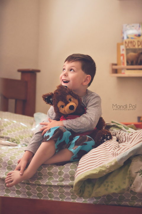 cute lifestyle portait of baby boy bedtime