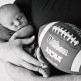 photo of newborn baby next to football