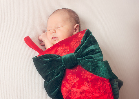 photo of newborn baby in a stocking