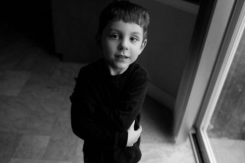 black and white photograph of cute little boy