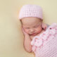 newborn portrait of baby girl with pink and yellow