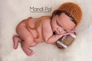 football themed newborn picture