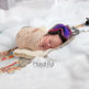 newborn portrait of baby girl in the snow with skiis