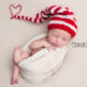 newborn portrait of baby girl in elf hat
