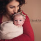 newborn portrait of baby girl in red